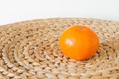 Apelsin på vävstolen Arkivfoto