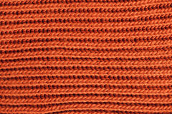 Apelsin stucken textur Ullgarn i handarbetebakgrund Arkivfoto