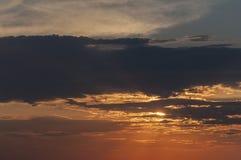 Apelsinen fördunklar under solnedgången Royaltyfri Foto