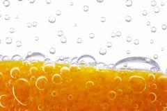 Apelsinen med bubblar royaltyfri bild