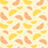 Apelsinen och citronen skivar den sömlösa modellbakgrundsillustrationen Royaltyfria Bilder