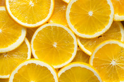 Apelsinen skivar bakgrund Fotografering för Bildbyråer