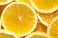 Apelsinen skivar bakgrund Arkivbild