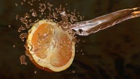 Apelsiner och fruktsaftfärgstänk Arkivbilder