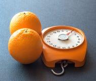 Apelsiner och våg Fotografering för Bildbyråer