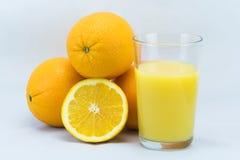 Apelsiner & OJ Royaltyfri Foto