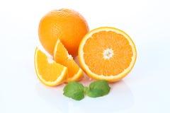 Apelsiner som isoleras arkivbild