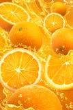 Apelsinfärgstänk Arkivbilder