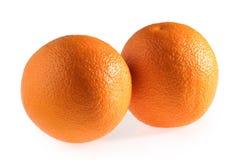 Apelsinfrukter som isoleras på vit bakgrund arkivfoto