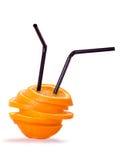 Apelsinsegment med sugrör två Arkivfoto