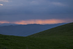 Apennines at sunset with green meadows and deep blue sky, Umbria, Italy Royalty Free Stock Images