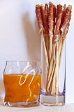 Aperitif. Juice and bread sticks with ham stock photo