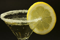 Aperitif. Martini cocktail glass with lemon Royalty Free Stock Photo