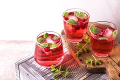 Aperitif with campari, mint and raspberry. Iced lemonade. Aperitif with campari, mint and raspberry, selective focus. Iced lemonade stock photography