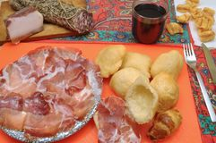Aperitif and dinner with salami and fried dumplings. Aperitif and dinner in a tavern with salami and fried dumplings Royalty Free Stock Photography