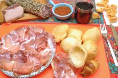 Aperitif and dinner with salami and fried dumplings. Aperitif and dinner in a tavern with salami and fried dumplings Royalty Free Stock Photo