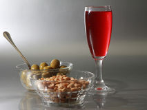 Aperitif red. Olive and nuts Royalty Free Stock Photos