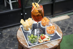 Aperitif and snacks in a pub. Aperitif with snacks olives and french fries royalty free stock photo