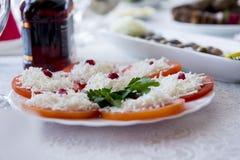 Aperitif von Tomaten mit Käse Lizenzfreie Stockbilder