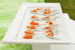 Aperitivi di color salmone marinati Immagine Stock