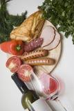 Aperitivo de la salchicha y vino rojo Imagen de archivo libre de regalías