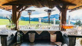 Aperitivo drinks with mountain background in Alto Adige / South Tyrol, Italy.  royalty free stock photography