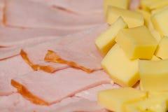 Aperitivos cortados de la carne y del queso Imagenes de archivo