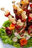 Aperitivos de la carne y de la verdura en los pinchos Foto de archivo libre de regalías
