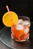 Aperol cocktail with orange slices and ice Stock Image
