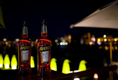 Aperol in front of the Charles Bridge - Prague. Unarranged photo. Downtown Prague. Behind the bottles you can see the silhouette of the Charles Bridge. Night Royalty Free Stock Photography