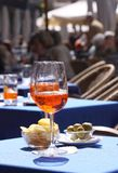 Aperol glasses at an outdoor cafe Stock Image