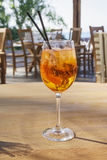 Aperol Spritz alcoholic drink on wooden table with blurred background. Stock Images