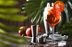 Free Aperol Spritz Cocktail In Big Wine Glass With Orange Slices, Summer Cool Fresh Alcoholic Cold Beverage. Wooden Bar Counter Stock Images - 144793664
