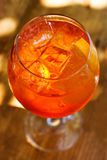 Aperol spritz cocktail in sunlights. Sparkling wine, champagne alcohol drink with ice cubes. Top view. Soft focus Stock Photography