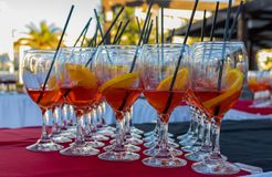 Aperol Spritz cocktails served as an aperitiv of a professional dinner. Aperol Spritz cocktails served as an aperitiv of a professional catering in high class stock image
