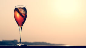 Aperol spritz at a wooden pier at sunset. Luxury resort vacation. Concept. Festive relax getaway background. Toned image. Horizontal, wide screen format Royalty Free Stock Photography