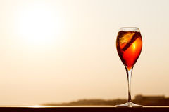Aperol spritz at a wooden pier at sunset. Luxury resort vacation. Concept. Festive relax getaway background. Toned image. Horizontal Stock Photography