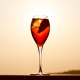 Aperol spritz at a wooden pier at sunset. Luxury resort vacation. Concept. Festive relax getaway background. Toned image. Square Stock Photography