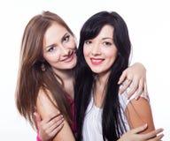 Aperto de duas mulheres. Fotografia de Stock