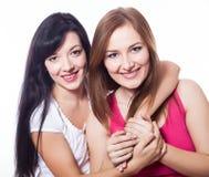 Aperto de duas mulheres. Imagens de Stock Royalty Free
