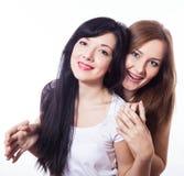 Aperto de duas mulheres. Imagens de Stock