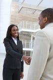 Aperto de mão africano da equipe do negócio Foto de Stock Royalty Free