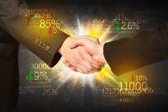Aperto de mão da economia Imagens de Stock