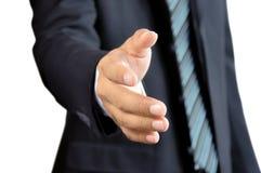 Aperto de mão de oferecimento da mão do homem de negócios Imagem de Stock Royalty Free