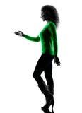 Aperto de mão de passeio da silhueta da mulher isolado Fotografia de Stock
