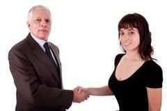Aperto de mão do homem de negócio uma mulher de negócio fotografia de stock