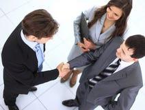 Aperto de mão e confiança do negócio tomados Imagens de Stock Royalty Free