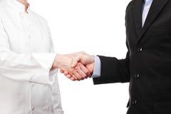Aperto de mão entre um cozinheiro e um homem de negócios Fotos de Stock Royalty Free