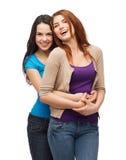 Aperto de riso de duas meninas Foto de Stock Royalty Free