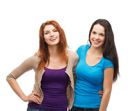 Aperto de riso de duas meninas Imagens de Stock